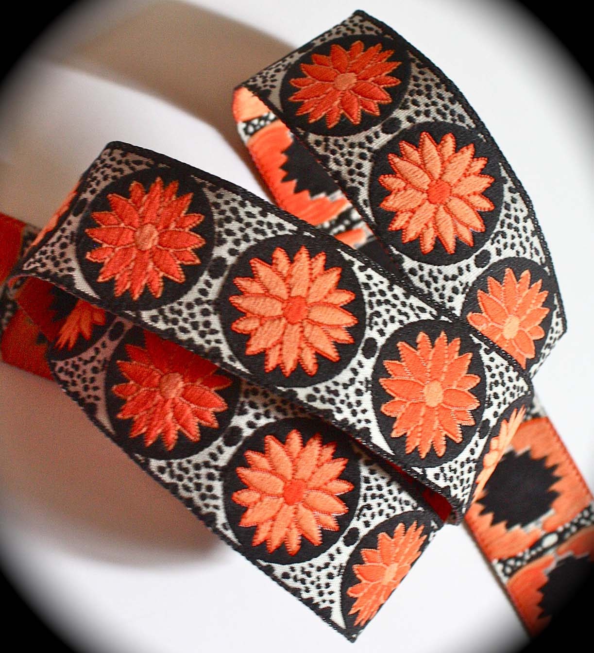 "DAISY DOT FLOWER16 1""x 3 yards Orange, Coral and Black"