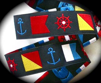 "NAUTICAL22a 1"" (25 YDS) NAVY/RED/WH/YEL  NAUTICAL FLAGS/WHEELS"